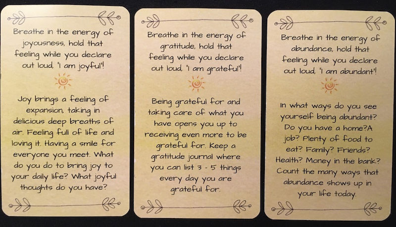 Back side of 3 Everyday Enlightenment Cards
